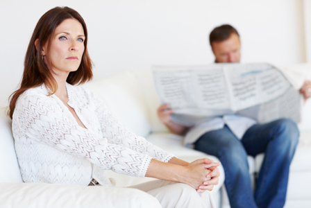 Upset woman on couch with boyfriend