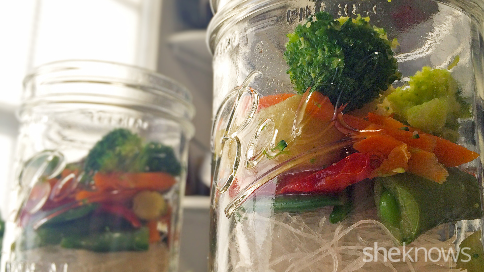 adding mixed vegetables to the jar