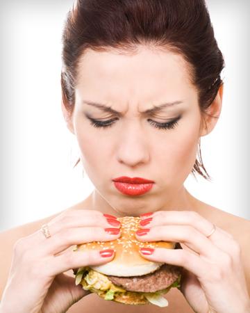 Woman looking at hamburger