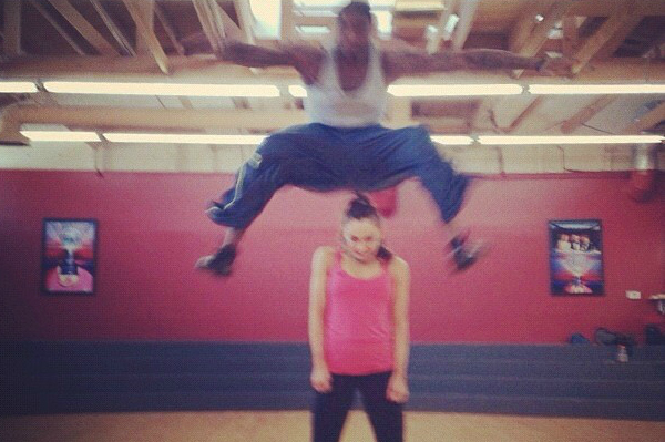 DWTS Jacoby Jones jumps over Karina Smirnoff