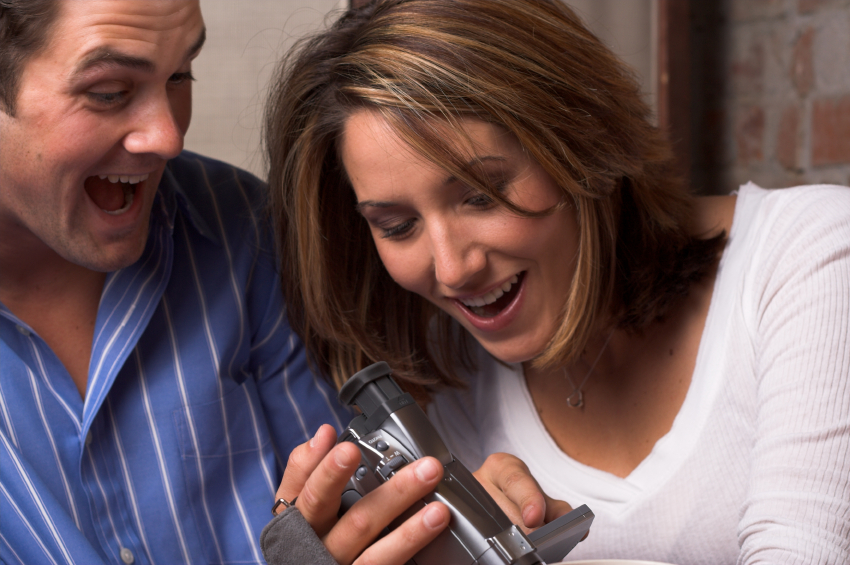 couple watching new family video footage