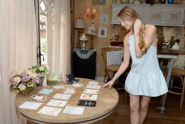 Whitney Port looking at wedding invites