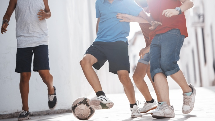 Children playing with soccer ball in
