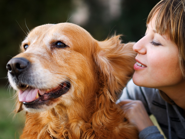 Woman and dog looking happy