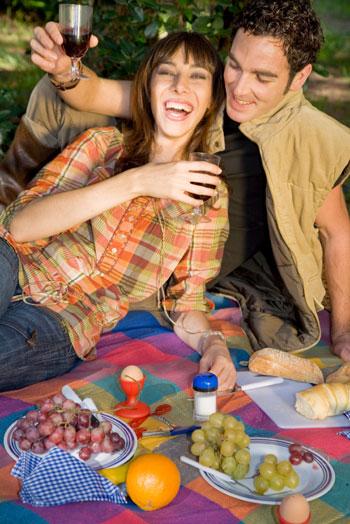 man and woman having picnic