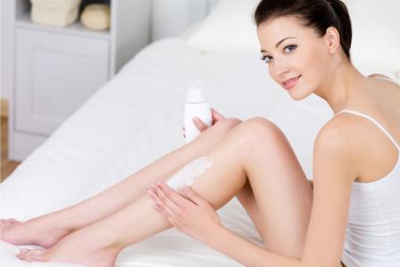 Woman applying lotion