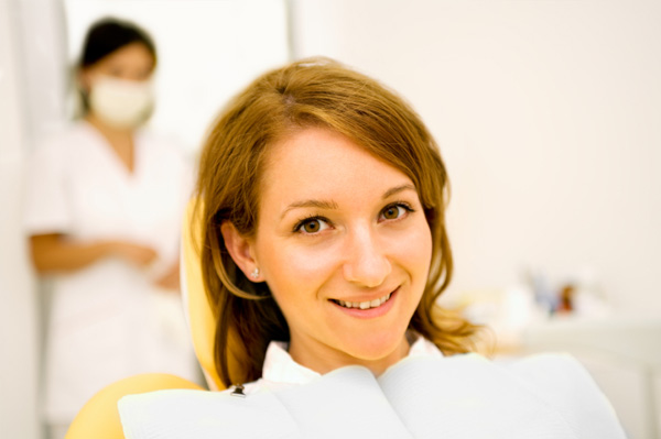 Woman having oral cancer screening