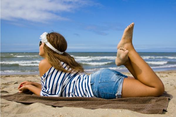 woman lounging on beach