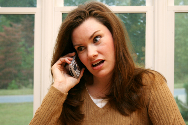 Woman being criticized on the phone