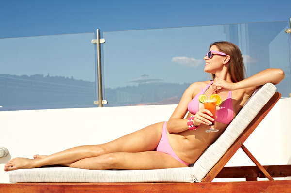 Woman having a cocktail outdoors
