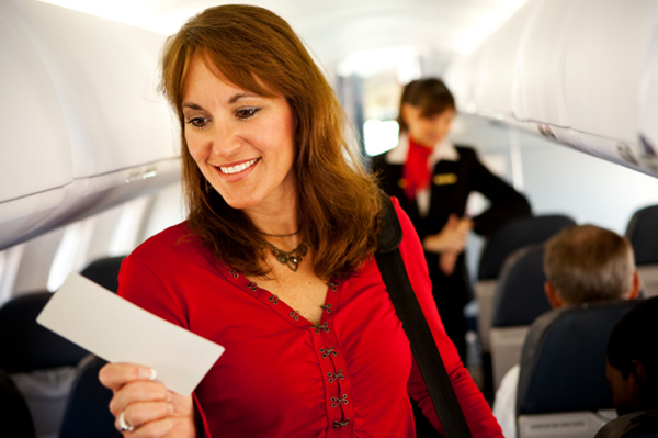 Woman boarding airplane
