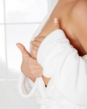 Woman doing breast self-exam