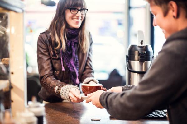 Woman buying coffee in coffee shop