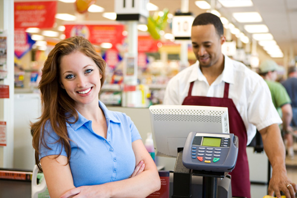 woman checking out at grocery store