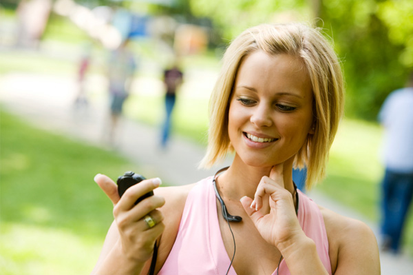 Woman checking pulse after workout
