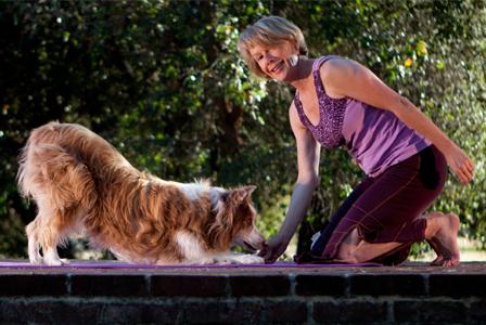 Woman and dog doing yoga