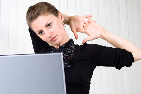 Woman doing back stretches at work
