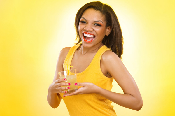 Woman drinking juice with straw