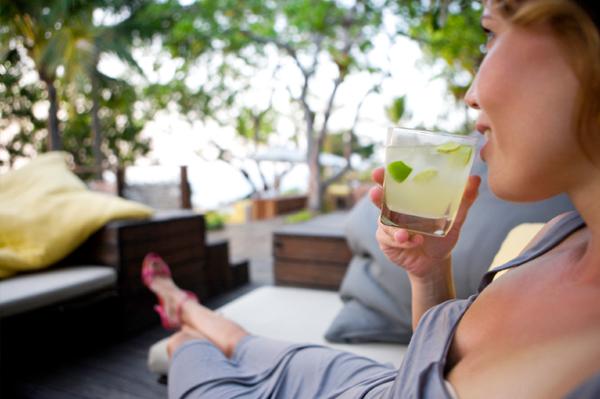 Woman drinking mojito