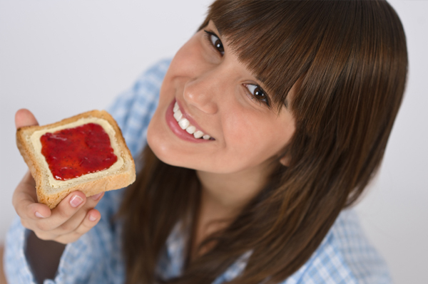 Woman eating toast