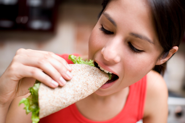 Woman eating wrap