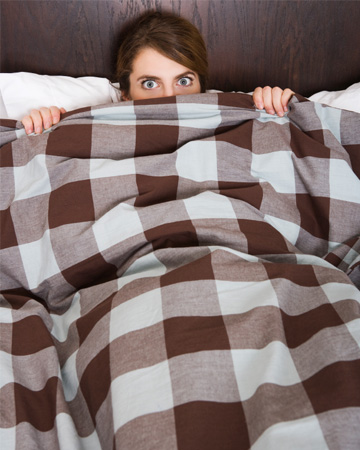 Woman embarssed in bed