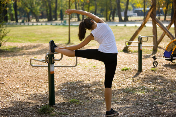 Woman exercising at playground