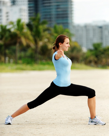 Woman exercising outside hotel