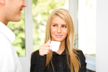 Woman flirting with man at office