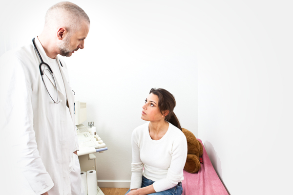 woman talking with doctor about colonoscopy