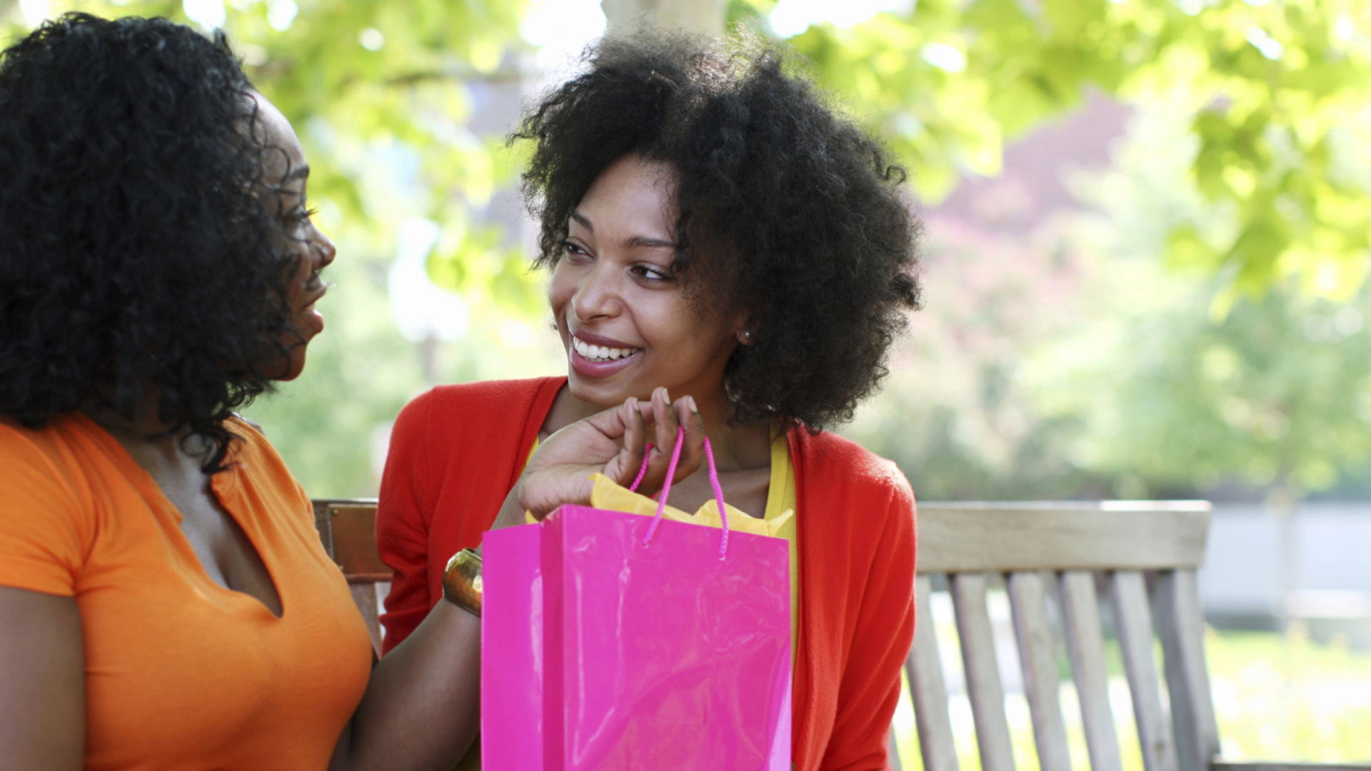 Woman giving friend gift