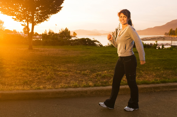 Woman going for walk at dawn