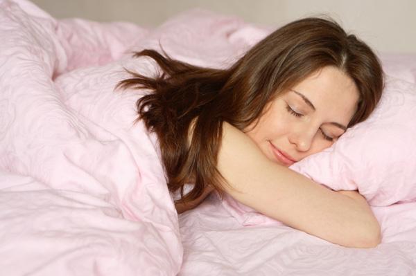 Woman happily sleeping