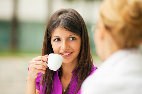 Woman having coffee with friend
