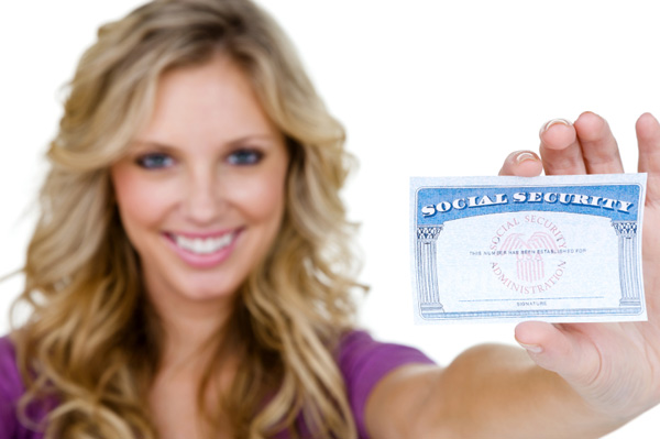 Woman holding her social security card