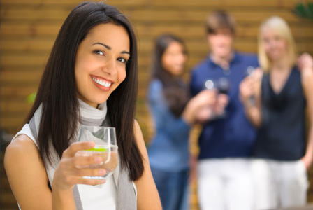 Woman hosting outdoor party