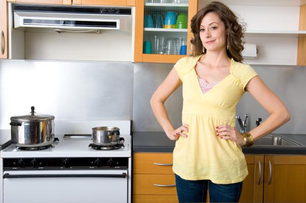 Woman in organized kitchen