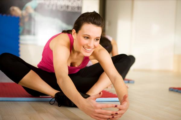 Woman wearing pink stretching