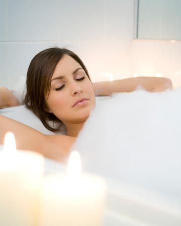 Woman in spa like bathroom