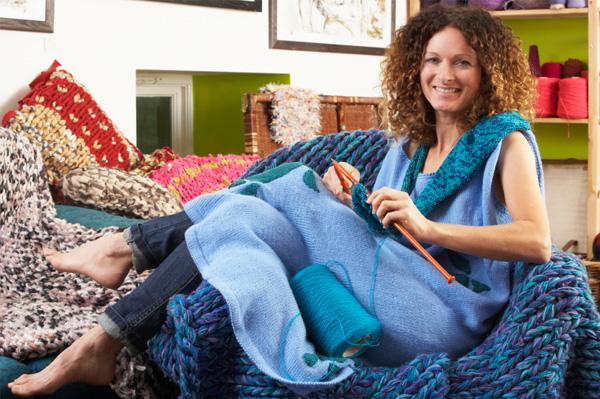 Woman knitting at home