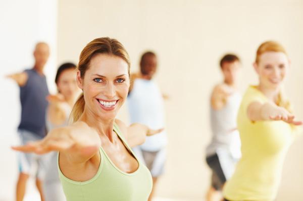 Woman leading yoga class