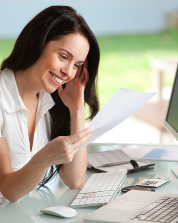 Woman looking over resume at home
