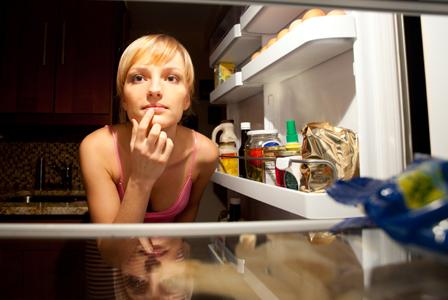 Woman looking into fridge
