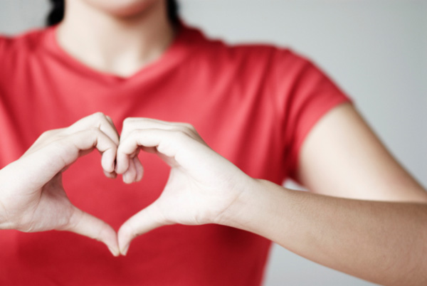 Woman making a heart with hands