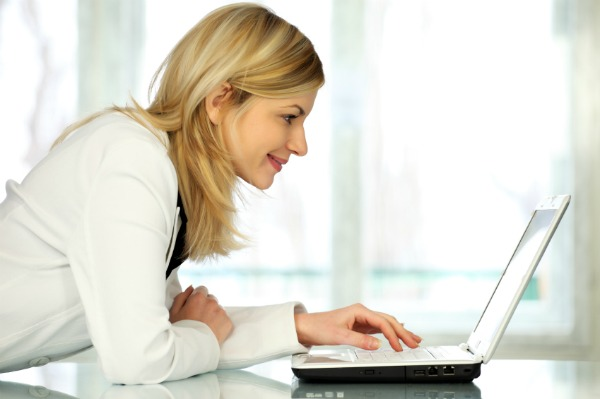 Woman on laptop blogging