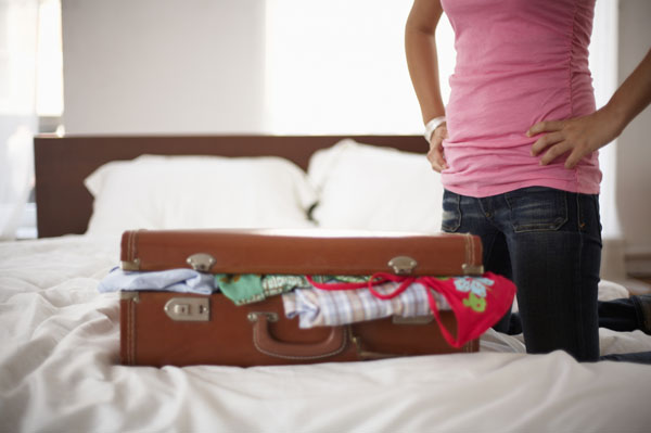 Woman packing her bag