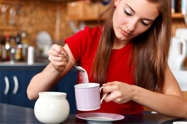 Woman pouring sugar
