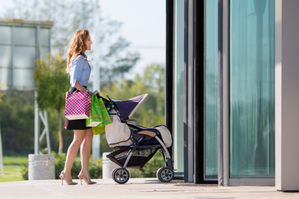 Woman pushing a stroller into the mall | Sheknows.com