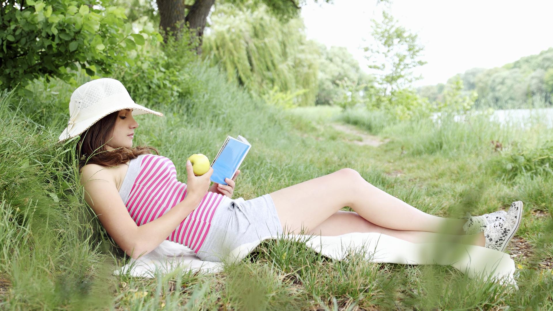 Woman reading a book | Sheknows.com