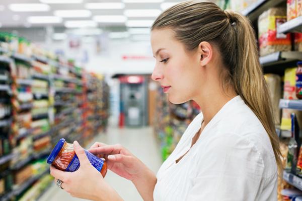 Woman reading label